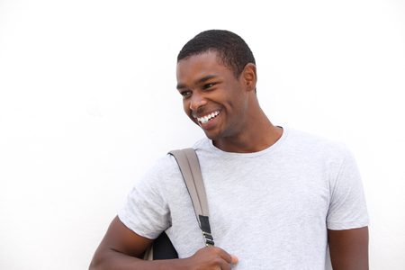 one young man: Close up portrait of a cheerful african american student smiling against white background
