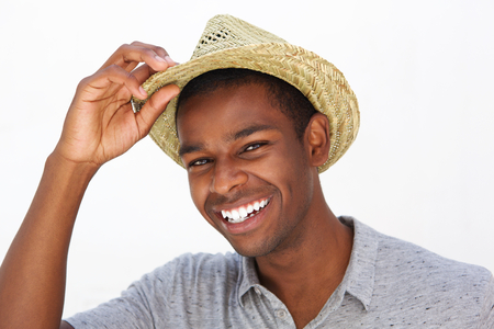 teeth smile: Close up portrait of a happy fashionable man smiling with hat on white background