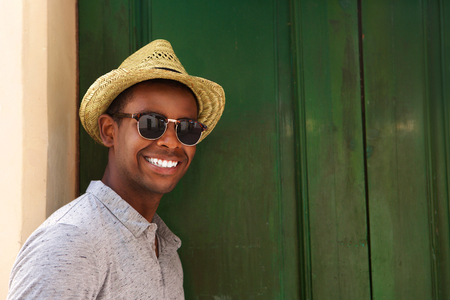 sunglasses: Close up portrait of a happy guy with hat and sunglasses