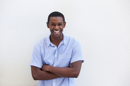 Portrait of a young black guy laughing on isolated white background Stock Photo
