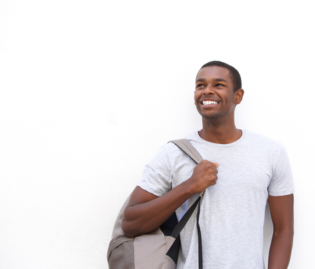 casual men: Portrait of a smiling african american male student thinking on isolated white background