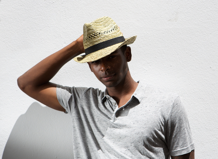 male fashion: Close up portrait of an african american male fashion model with hat Stock Photo
