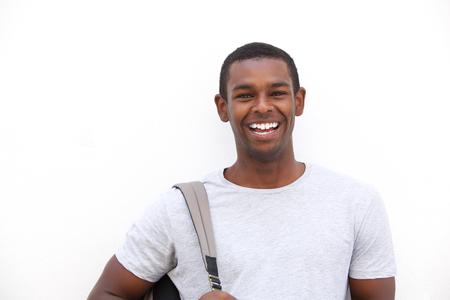 jovenes estudiantes: Close up retrato de una feliz estudiante universitario negro sonriente sobre un fondo blanco aislado Foto de archivo