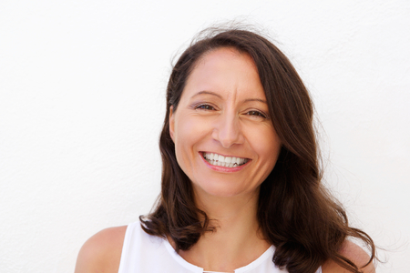 Close up portrait of a smiling mid adult woman posing against white background Stok Fotoğraf - 42743856