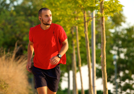 keeping fit: Young man exercise running outdoors keeping fit