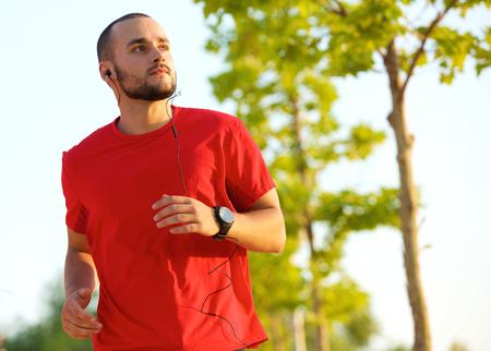 body: Young man enjoying a run outdoors keeping in shape