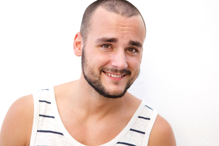 male face: Close up portrait of a handsome young man with short hair and beard Stock Photo