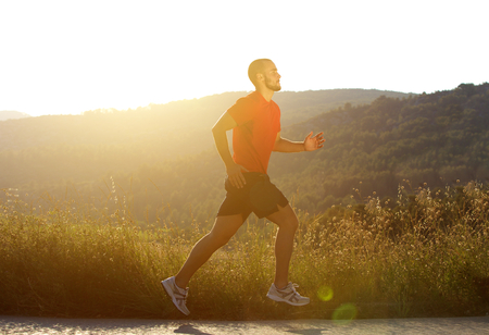 man health: Side portrait of a sports man running outdoors