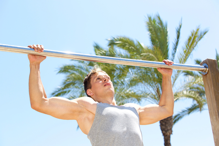 pull up: Active man pull up exercise workout outside Stock Photo
