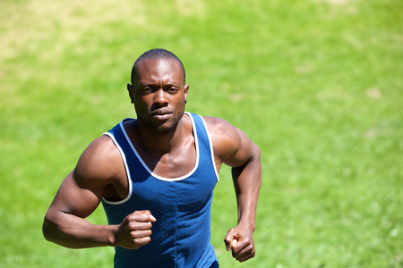 Portrait of an attractive african american man running outside