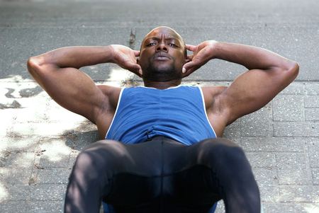 crunch: Sports man working on stomach crunch exercises