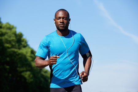 man relax: Portrait of a fit young african american man running outdoors