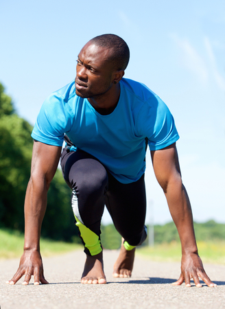 shoeless: Bare foot african american sports man stretching exercise workout Stock Photo
