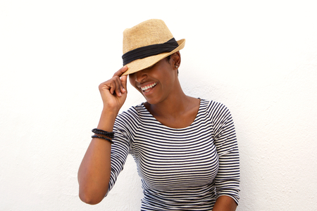 black hat: Portrait of one african american woman smiling with hat against white background