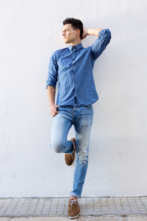 good looking boy: Full body portrait of an attractive male fashion model posing against white background Stock Photo
