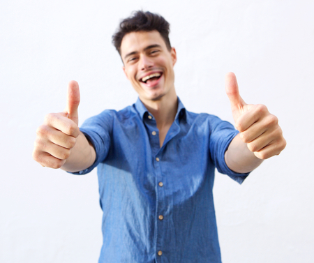 Portrait of a happy guy with thumbs up hand sign