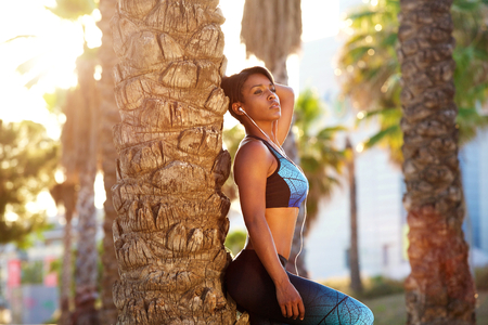 black girl: Side portrait of a beautiful african american sporty woman relaxing outside