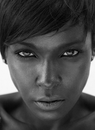 Close up black and white portrait of a beautiful african american woman staring