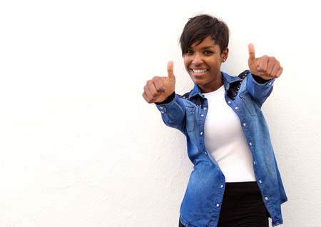 Portrait of a smiling african american woman with thumbs up