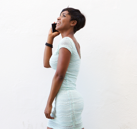 stylish woman: Side portrait of a smiling african american woman talking on mobile phone