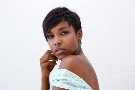female pose: Close up side portrait of a beautiful african american fashion model with short hair