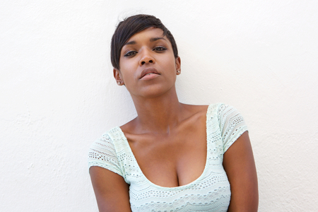 american sexy: Close up portrait of a beautiful young african american woman with short hair