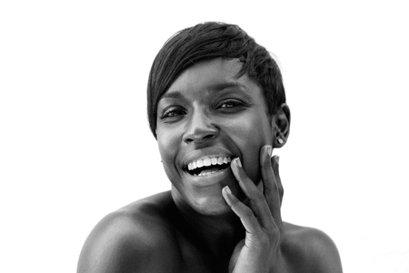 Close up black and white portrait of a cheerful african american woman