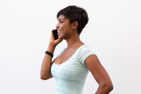 Close up portrait of a smiling african american woman talking on cell phone
