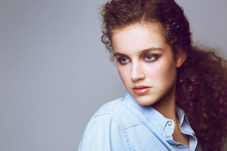 cute teen girl: Close up portrait of an attractive young fashion model with curly hair