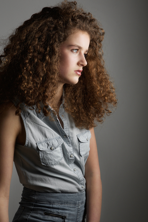 Portrait of a beautiful young female fashion model with curly hair Stock Photo