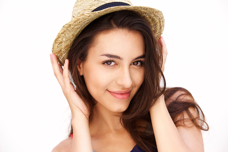 beautiful background: Close up portrait of a cute girl with hat smiling against white background Stock Photo