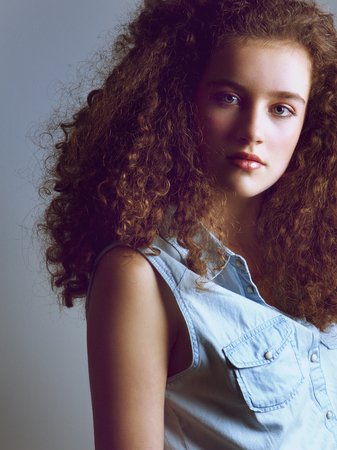 cross processed: Close up cross processed portrait of a beautiful young fashion model in denim shirt Stock Photo