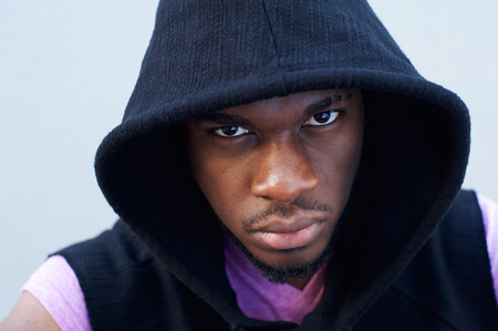 cool guy: Close up portrait of a cool black guy with hood sweatshirt