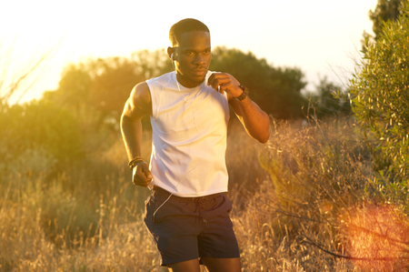 young male: Portrait of a healthy young african american man running outside