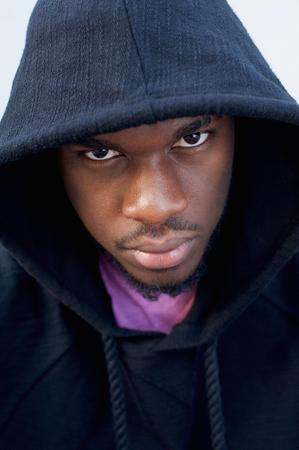 black guy: Close up portrait of a tough looking black guy with hood sweatshirt Foto de archivo