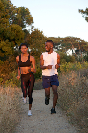 Portrait of two african american runners exercising outdoors photo