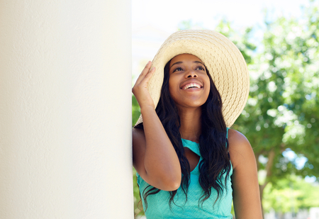 Close up portrait of a cute african american woman smiling with sun hat