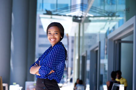 charming business lady: Portrait of a smiling african business woman with arms crossed