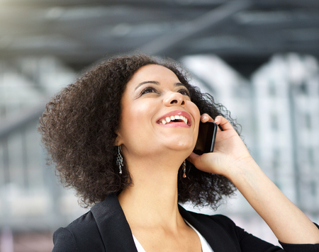 black professional: Close up portrait of a african american business woman talking on cellphone Stock Photo