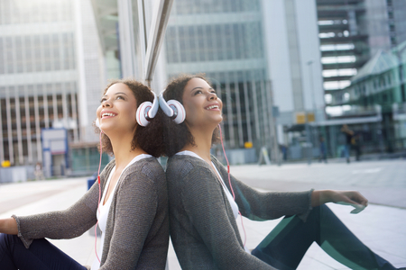 modern girls: Portrait of a cool african american girl enjoying music on headphones Stock Photo