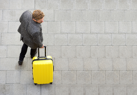Top view travel man walking with suitcase