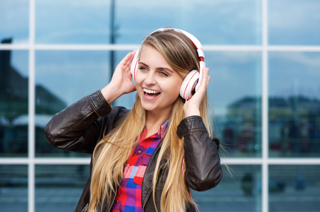 one young woman: Close up portrait of a young woman enjoying music on headphones