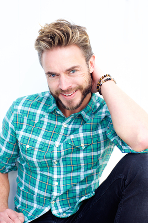male fashion: Close up portrait of a male fashion model with beard smiling