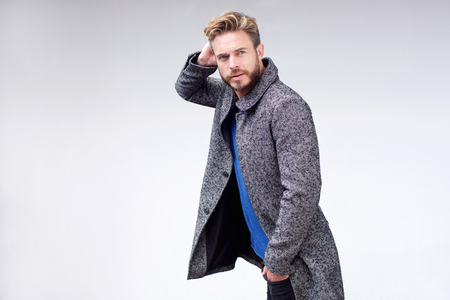 one man: Portrait male fashion model walking with hand in hair