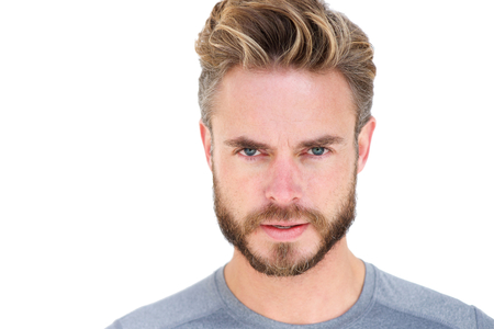 Close up portrait isolated of a handsome man with beard staring