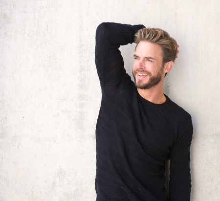 black sweater: Portrait of a smiling male fashion model posing in black sweater