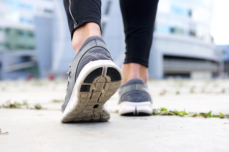 low angle: Low angle rear sport shoes walking outside Stock Photo