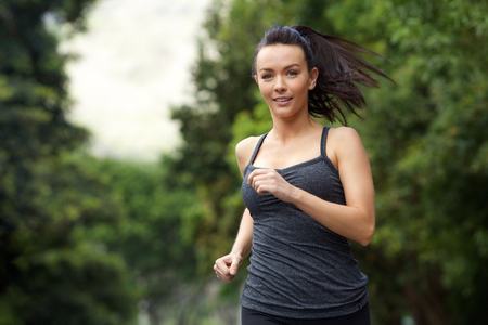 enjoy space: Portrait of an active woman running outdoors