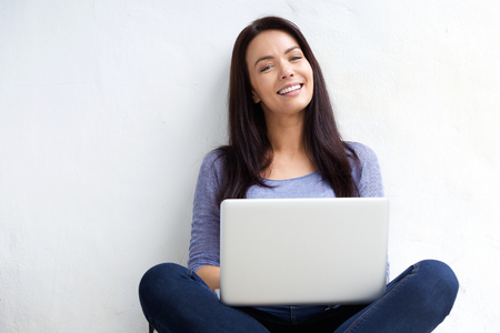 young  brunette: Portrait of a relaxed female student using laptop