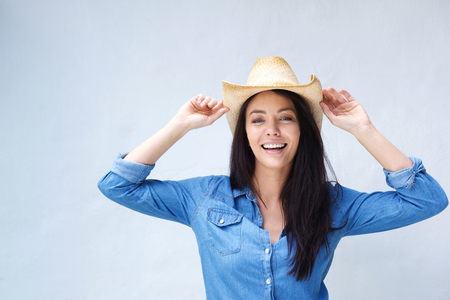 Portrait of a cheerful woman laughing with cowboy hat Stock fotó